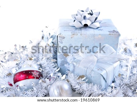 Two gift boxes with Christmas ornaments on white background