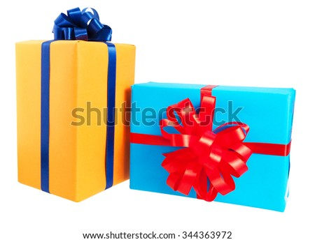 Two gift boxes wrapped in colorful paper, ribbon, bow ,Isolated on white. for anniversary, new year, birth day - stock photo