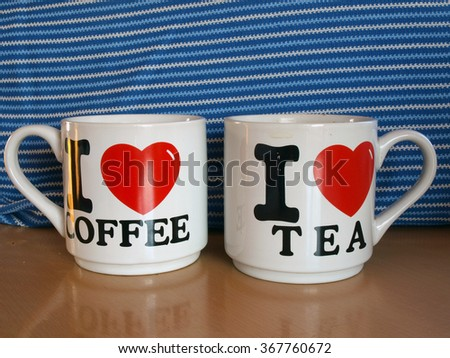 Two gift mugs for coffee and tea on table close up. - stock photo