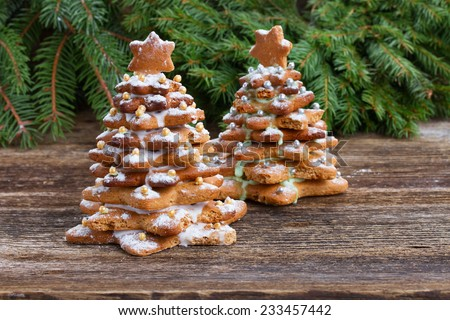 two gingerbread christmas tree with evergreen twing - stock photo