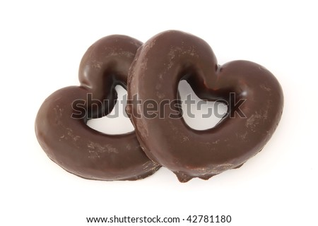 Two gingerbread hearts covered with chocolate
