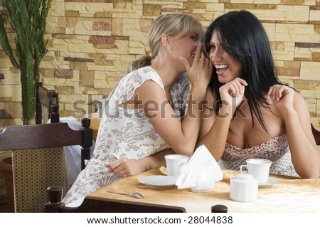two girl chatting as close friend sitting in a cafe - stock photo