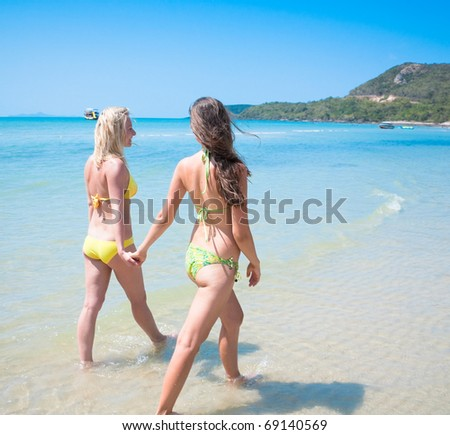 Two girl friends on exotic resor t