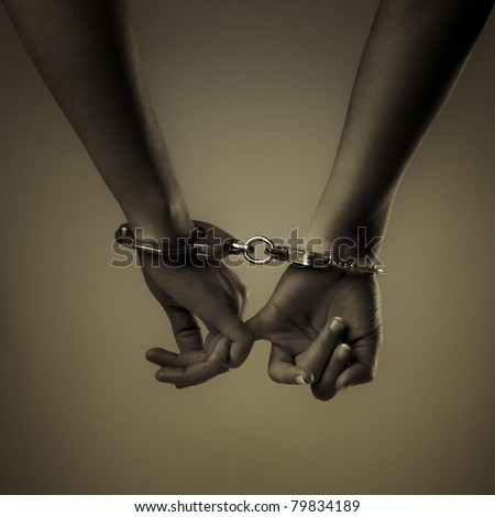 two girl hand and handcuffs, love symbol - stock photo