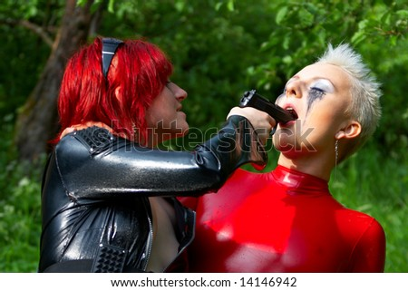 Two girl in latex. - stock photo