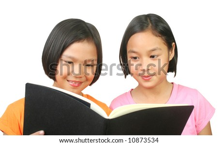 Two girl reading book. - stock photo