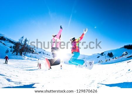 two girl snowboarders having fun - stock photo