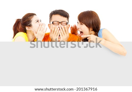 two girl talk to young man about surprising news - stock photo