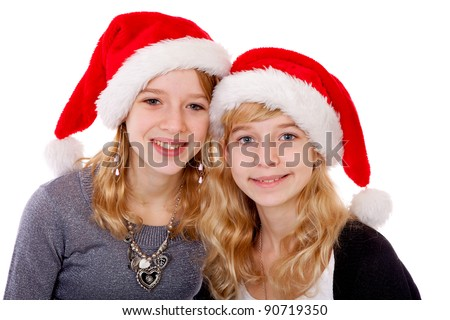 Two girl with christmas hat posing over white background