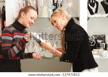 Two girlfriends   looking for accessories for wedding