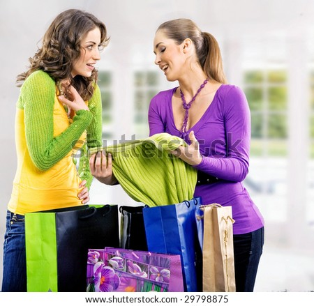 Two girls after shopping trip - stock photo