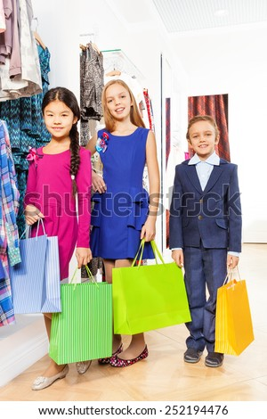 Two girls and boy with colorful  shopping bags