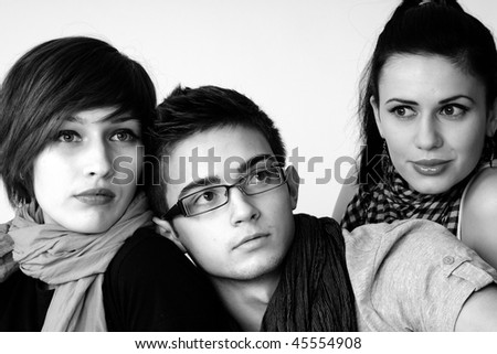 two girls and one man - stock photo