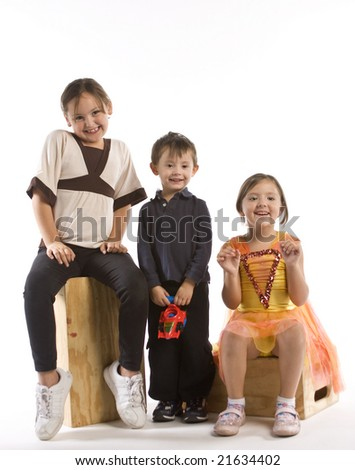 Two girls and their brother acting silly - stock photo