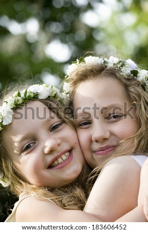 Two girls are happy - First Communion - stock photo