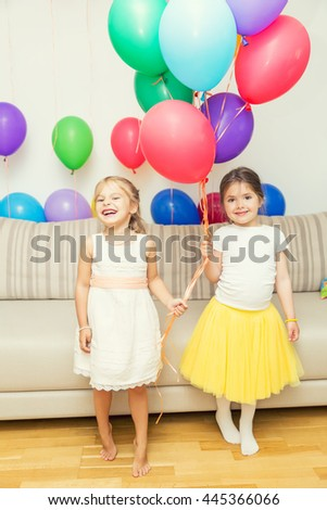 Two girls at birthday party - stock photo