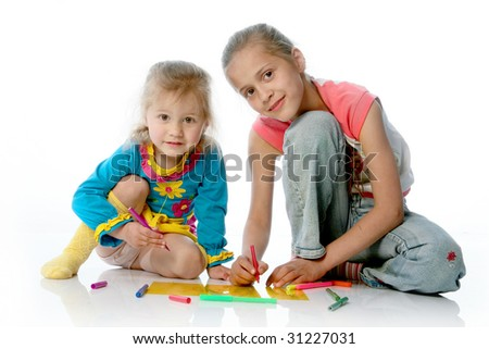 two girls draw