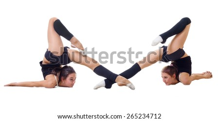 Two girls engaged art gymnastic isolated - stock photo