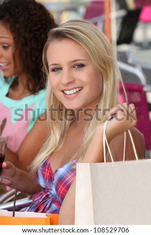 Two girls enjoying shopping trip - stock photo