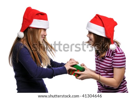 Two girls fighting over a present isolated on a white background