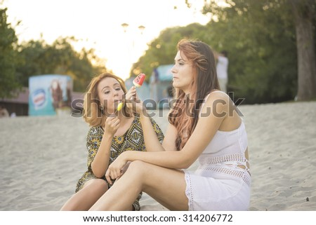 Two girls friends, eating ice cream.