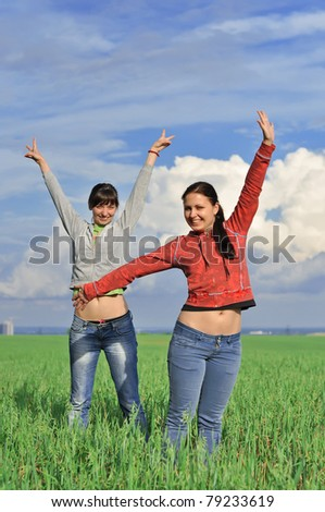Two girls in a field