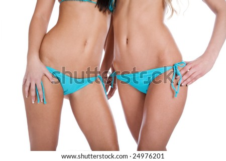 Two girls in bathing suits of blue on a white background - stock photo