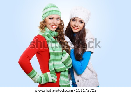 Two girls in bright and warm winter wear
