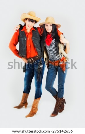 two girls in costumes of cowboys - stock photo