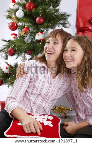 two girls in front of Christmas tree