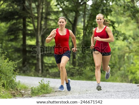 two girls in jogging - stock photo