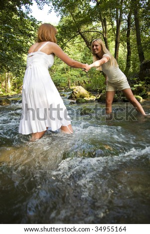 Two Girls In White Crossing The Cold Stream