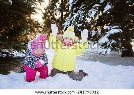 two girls in winter forest - stock photo