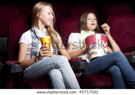 two girls look cinema