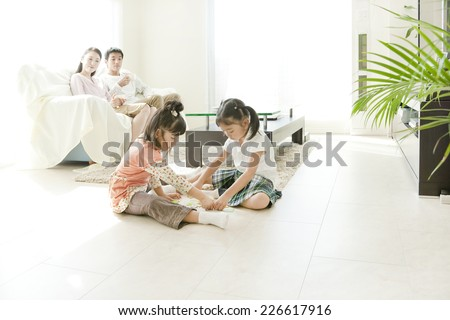 Two girls playing - stock photo