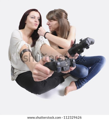 two girls playing video games - stock photo