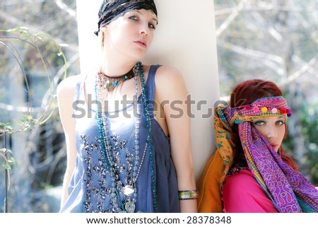 two girls posing in fashion clothes - stock photo