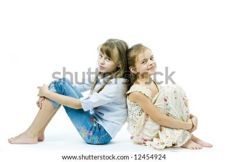 Two girls seated - stock photo