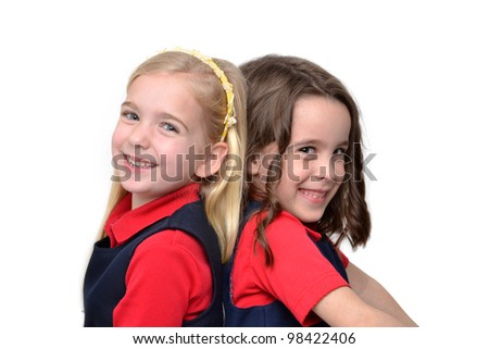 two girls sitting back to back - stock photo