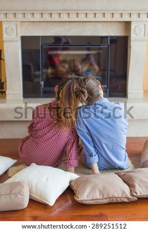 Two girls sitting in the living room together. - stock photo