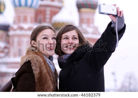 Two girls tourists are photographed in Moscow (Russia) - stock photo
