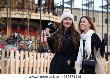 Two girls tourists are photographed in Moscow (Russia) winter 2015 - stock photo