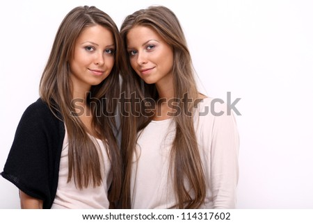 Two girls twins, isolated on the white