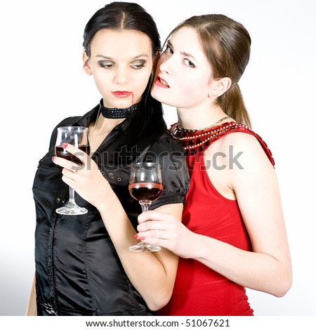 Two girls-vampires in red and black dresses