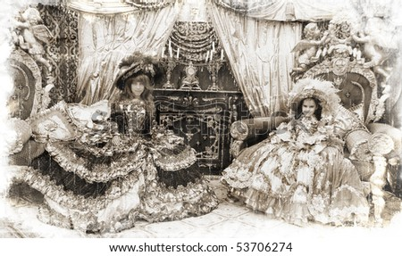 Two girls wearing antique princess dress and sitting on princess thrones (vintage style) - stock photo