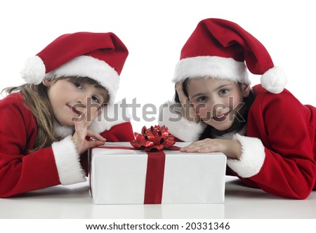 two girls with Christmas hat and presents - stock photo