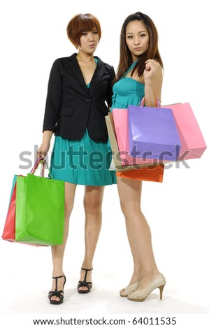 Two girls with shopping bags. Isolated over white background. - stock photo