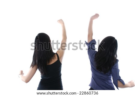 Two girls with their hands up isolated over white - stock photo