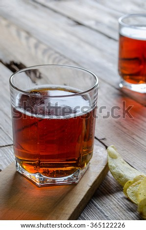 Two glass beer on wood background