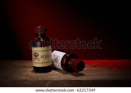 Two glass bottles of poison - stock photo